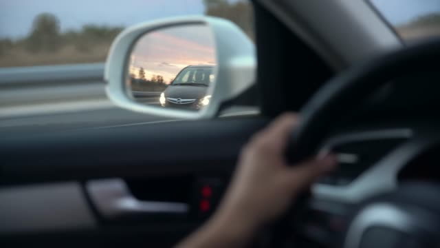 cu view of car passing in side view mirror - moving past stock videos & royalty-free footage