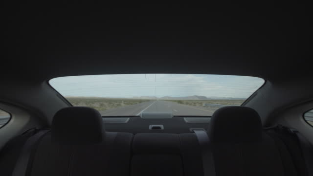 View of car rear window while driving