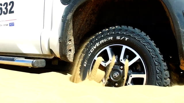 view of car stuck in sand/inner mongolia, china. - hitting stock videos and b-roll footage