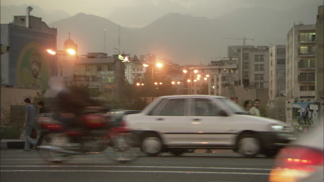 ws view of car traffic in tehran at twilight / tehran, tehran province, iran  - teheran video stock e b–roll