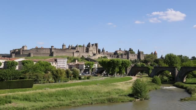 view of carcassonne across river - carcassonne stock videos & royalty-free footage