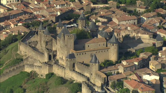 aerial, view of carcassonne, languedoc-roussillon, france - carcassonne stock videos & royalty-free footage