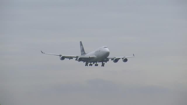 ws pan view of cargo airplane landing  / findel-airport, luxembourg, luxembourg-city, luxembourg - cargo aeroplane stock videos & royalty-free footage