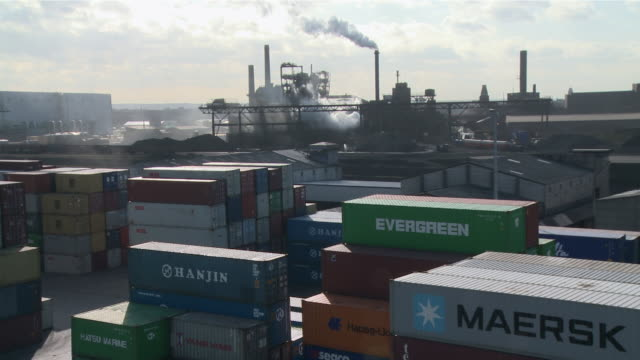 ws view of cargo containers at harbor and steel mill in background / duisburg, north rhine westfalia, germany - metal industry stock videos & royalty-free footage