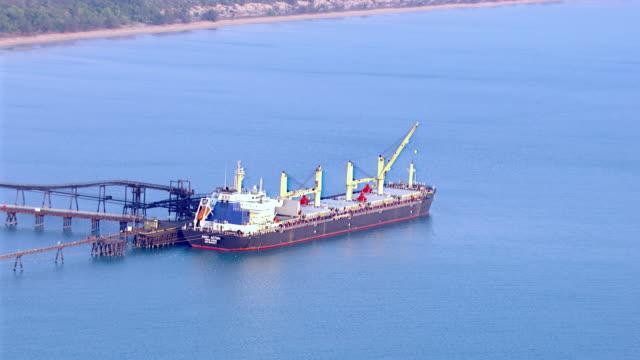 WS AERIAL View of cargo ship and coal mine area / Darwin, Northern Territory, Australia