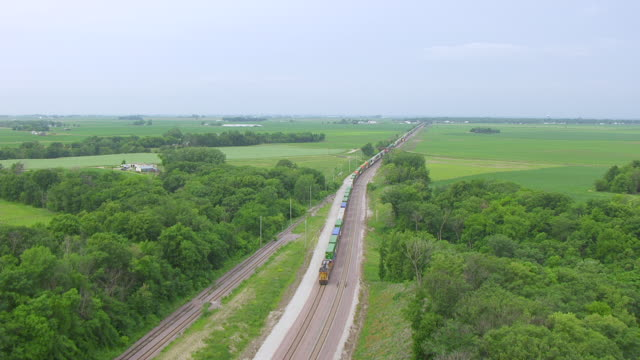 WS TU AERIAL POV View of cargo train and farmland / Boone, Iowa, United States