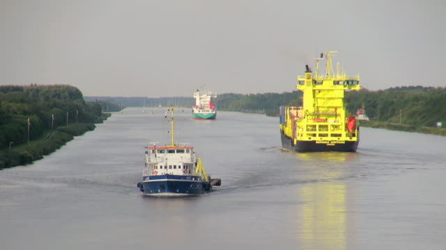 ws pov view of cargo vessels moving near brunsbuttel, kiel kanal, schleswig holstein, germany / hamburg, germany - schleswig holstein stock videos & royalty-free footage