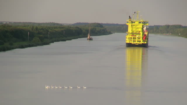 ws pov view of cargo vessels moving near brunsbuttel on kiel kanal, schleswig holstein / hamburg, germany - schleswig holstein stock videos & royalty-free footage