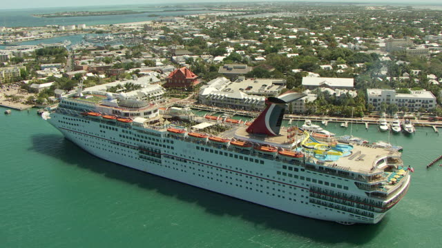 ms aerial view of carnival cruise ship passengers and chairs / key west, florida, united states - ponte di una nave video stock e b–roll