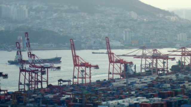 view of carrying cargo containers on the busan harbor (largest port in south korea) during the day in busan - porter stock videos & royalty-free footage
