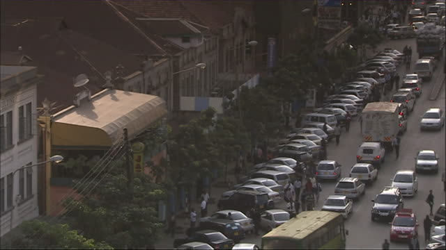 ms td view of cars and pedestrian traffic on street / nairobi, nairobi province, kenya - nairobi stock videos and b-roll footage