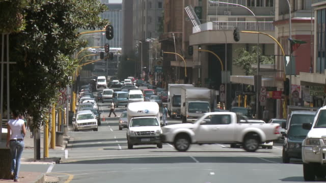 WS View of cars driving along busy street in cbd / Johannesburg, Gauteng, South Africa