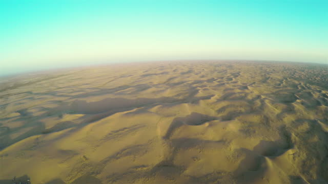 aerial view of cars in tengger desert at sunset/alashan, inner mongolia, china. - tengger stock videos & royalty-free footage