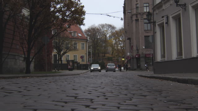 ws la view of cars moving on road / riga, latvia - 1 minute or greater stock videos & royalty-free footage