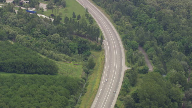 WS AERIAL View of cars running on highway and farm fields / Rhone Alpes, France
