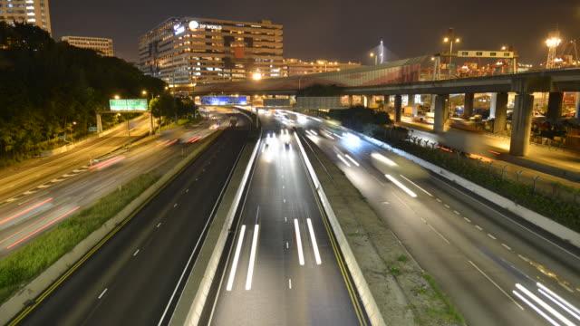 ws t/l ha view of cars running on highway / hong kong, china - main road stock videos & royalty-free footage