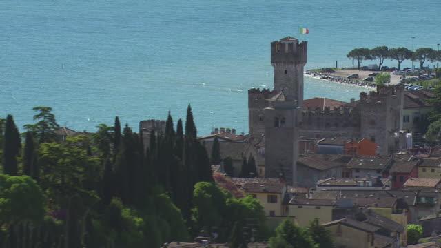 WS AERIAL View of caste and trees / Lake Garda, Trentino, Verona, Brescia