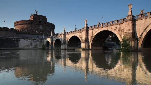 ws view of castel sant angelo, ponte sant angelo and river tiber / rome, lazio, italy  - ponte stock videos & royalty-free footage