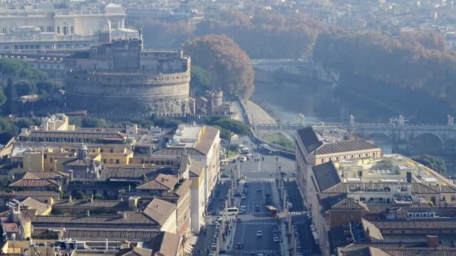 WS T/L ZO PAN View of Castel Sant'Angelo and traffic amidst dense buildings
