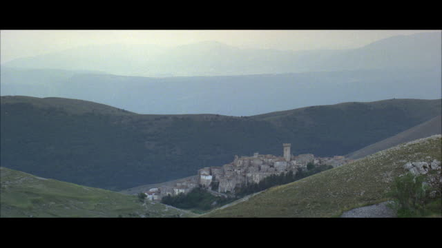 ws view of castle, abbey or monastery on mountain top - abbey stock videos & royalty-free footage