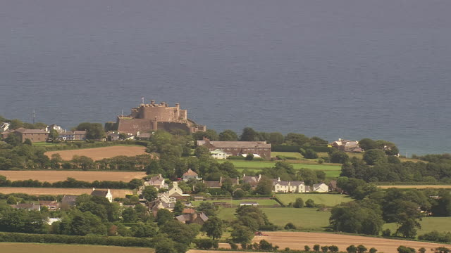 WS AERIAL View of castle and beach / Guernsey, Channel Isles