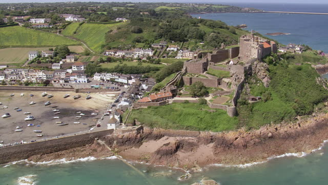 WS AERIAL View of castle and harbor / Guernsey, Channel Isles