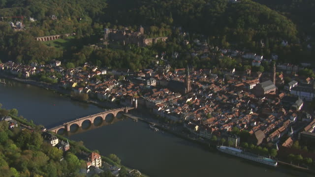 ws aerial view of castle bridge on river and church with buildings / heidelberg, baden wurttemberg - heidelberg castle stock videos & royalty-free footage
