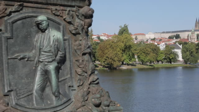view of castle district & vltava with st. vitus cathedral and royal palace, prague, czech republic, europe - レリーフ点の映像素材/bロール
