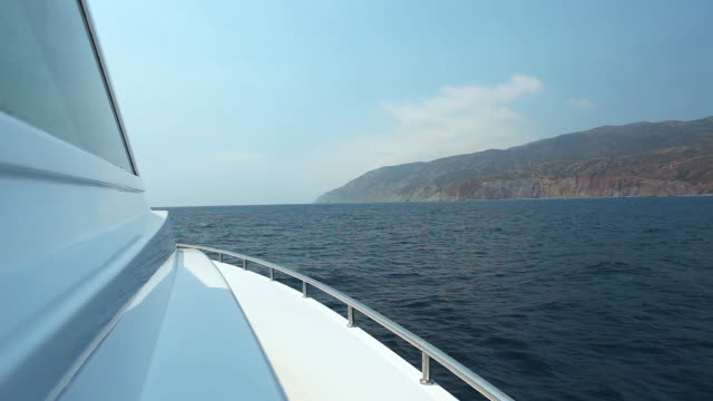 ws pov view of catalina coastline from yacht / catalina island, ca, united states  - channel islands california stock videos & royalty-free footage
