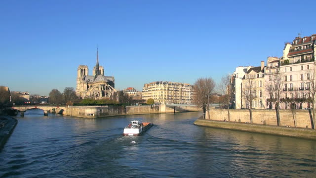 ws view of cathedral notre dame and boat in river / paris, ile de france, france - ile de france stock videos and b-roll footage