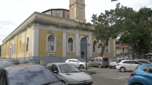 view of catholic church of st. peter and st. paul and busy street, pointe-a-pitre, guadeloupe, french antilles, west indies, caribbean, central america - french overseas territory stock videos & royalty-free footage