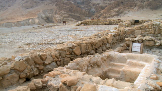 WS PAN View of caves of Qumran near Dead sea with people in background / Qumran,  Judea Desert,  Isarel