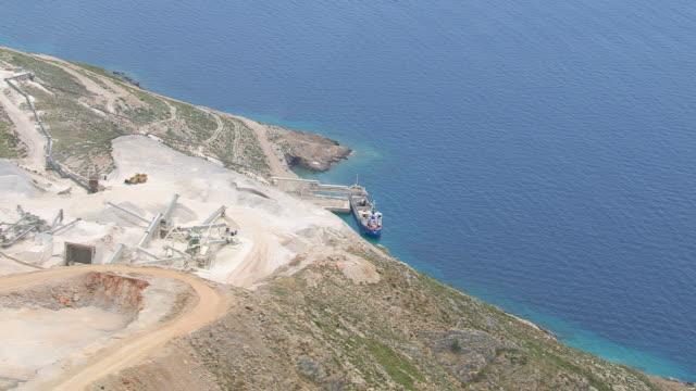 vídeos de stock, filmes e b-roll de ws zi aerial view of cement freighter / leros, cyclades, greece - atracado