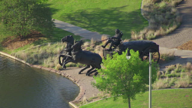 ms aerial view of centennial land run monument by water / oklahoma city, oklahoma, united states - rappresentazione di animale video stock e b–roll