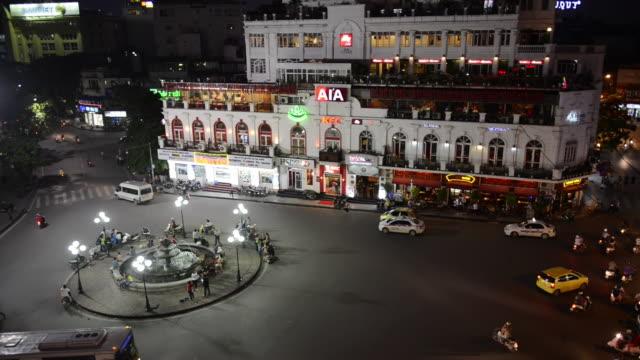 vídeos y material grabado en eventos de stock de ws view of central hanoi at dusk / hanoi, vietnam - letrero de tienda
