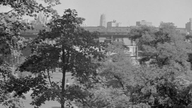 ws view of central park area and buildings in back side and elevated train on bridge - elevated train stock videos & royalty-free footage