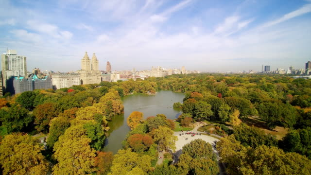 WS AERIAL POV View of Central Park lake with city in background / Manhattan, New York City, New York State, United States