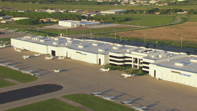 ms aerial zi view of cessna mid continent airport with cessna citation sign on building / wichita, kansas, united states - airfield stock videos & royalty-free footage