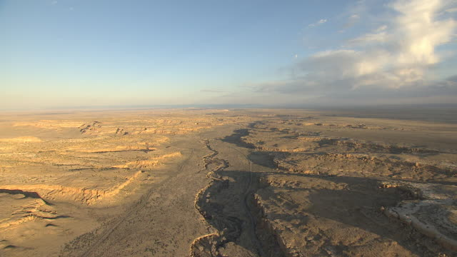 ws aerial view of chaco canyon national historical park under big open sky / new mexico, united states - chaco culture national historical park stock videos & royalty-free footage