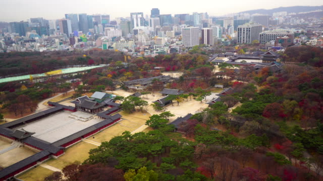 View of Changgyunggung Palace (Ancient Palace in Seoul) and cityscape in autumn season at day