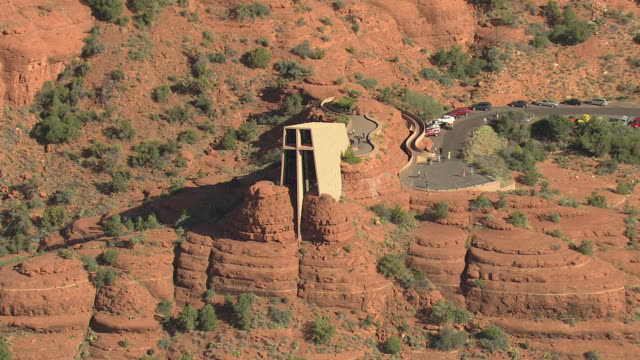ws aerial view of chapel of the holy cross built into the mesas / sedona, arizona, united states  - arizona video stock e b–roll