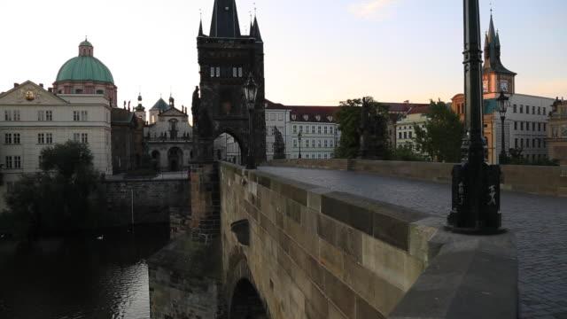 view of charles bridge from charles bridge at sunrise, prague, czech republic, europe - charles bridge stock videos & royalty-free footage