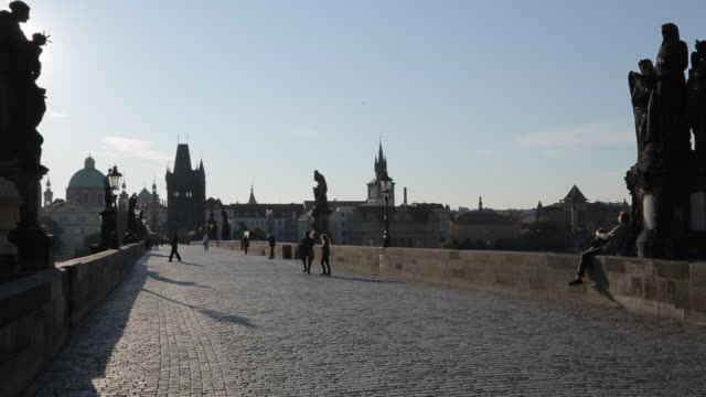view of charles bridge from charles bridge at sunrise, prague, czech republic, europe - charles bridge stock videos & royalty-free footage