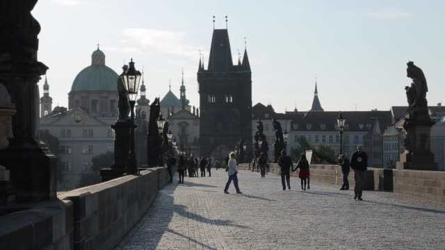 view of charles bridge from charles bridge at sunrise, prague, czech republic, europe - charles bridge stock videos and b-roll footage