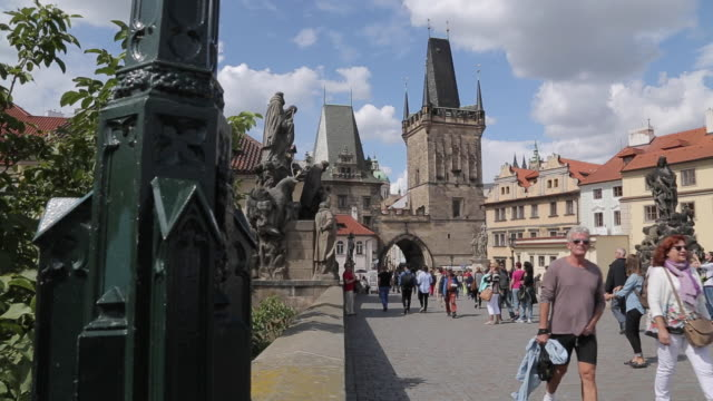 view of charles bridge & tourists, prague, czech republic, europe - charles bridge stock videos and b-roll footage