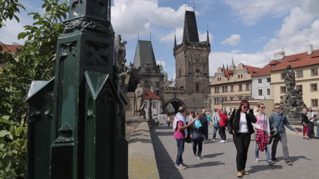 view of charles bridge & tourists, prague, czech republic, europe - charles bridge stock videos & royalty-free footage