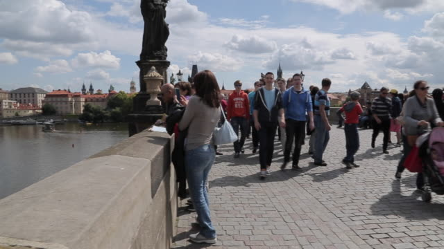 view of charles bridge & vltava, old town and river boats, prague, czech republic, europe - charles bridge stock videos & royalty-free footage