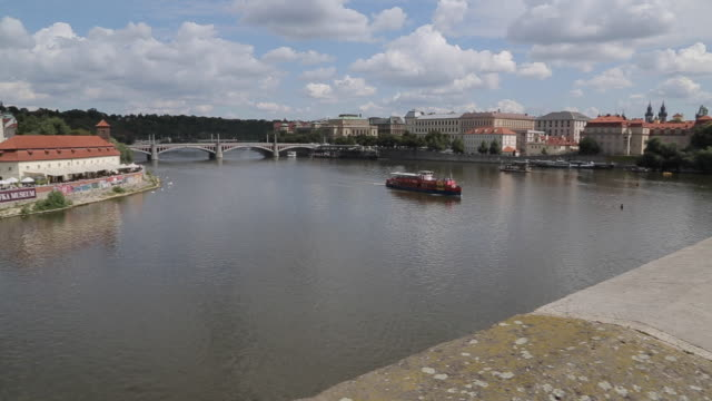 view of charles bridge & vltava, old town and river boats, prague, czech republic, europe - river vltava stock videos & royalty-free footage
