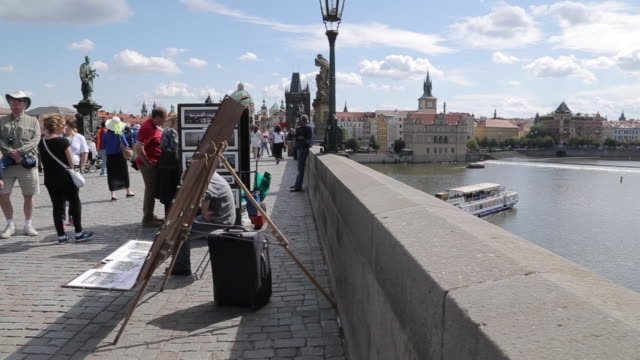 view of charles bridge & vltava, old town and river boats, prague, czech republic, europe - river vltava stock videos and b-roll footage