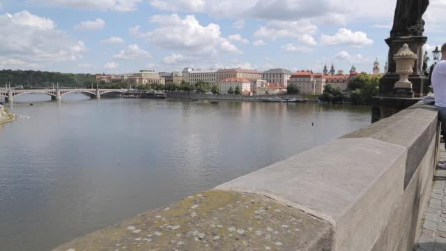view of charles bridge & vltava, old town, prague, czech republic, europe - charles bridge stock videos & royalty-free footage